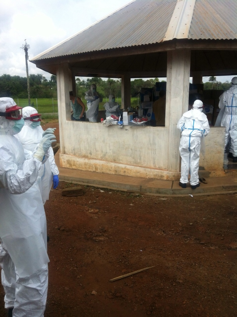 Workers in PPE suits in Lunsar, Sierra Leone